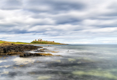 ENG16250AW A view towards Dunstanburgh Castle, Northumberland, England