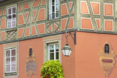 HMS3407595 France, Haut Rhin, Route des Vins d'Alsace, Colmar, facade of a half timbered house in trompe l'oeil on Place de l'Ancienne Douane (former custom square)