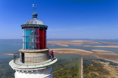 HMS3286813 France, Gironde, Verdon sur Mer, rocky plateau of Cordouan, lighthouse of Cordouan, classified Monument Historique, the lighthouse keeper at low tide (aerial view)