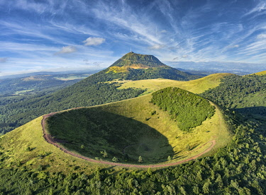 HMS3348173 France, Puy de Dome, Orcines, Regional Natural Park of the Auvergne Volcanoes, the Chaîne des Puys, listed as World Heritage by UNESCO, Puy Pariou volcano in the foreground (aerial view)