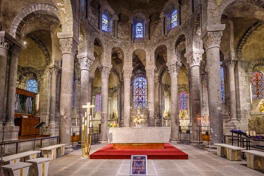 HMS3405844 France, Puy de Dome, Auvergne Volcanoes Regional Nature Park, Monts Dore mountain range, Orcival, 12th century Notre Dame d'Orcival basilica, choir, granite high altar, statue of the Virgin in Majesty...