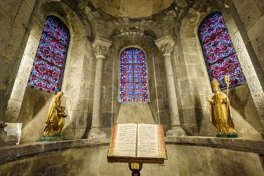 HMS3405853 France, Puy de Dome, Auvergne Volcanoes Regional Nature Park, Dore Mountains, Orcival, 12th century Notre Dame d'Orcival basilica, liturgical book of songs