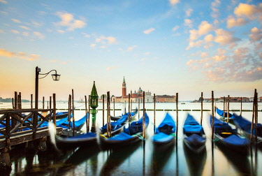 ITA14850 Italy. Veneto. Venice. Gondolas on the Bacino di San Marco with the Church on the Island of San Giorgio Maggiore.