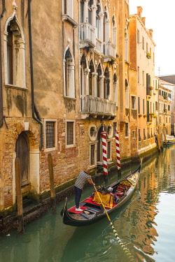 IT02986 Gondola on a canal in Castello, Venice, Veneto, Italy