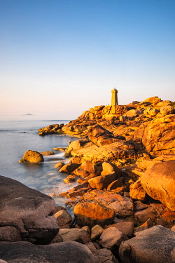 HMS3341944 France, Cotes d'Armor, Pink Granite Coast, Perros-Guirec, on the Customs footpath or GR 34 hiking trail, Ploumanac'h or Mean Ruz lighthouse at sunset