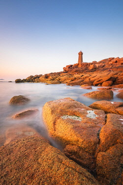 HMS3341955 France, Cotes d'Armor, Pink Granite Coast, Perros-Guirec, on the Customs footpath or GR 34 hiking trail, Ploumanac'h or Mean Ruz lighthouse at sunset