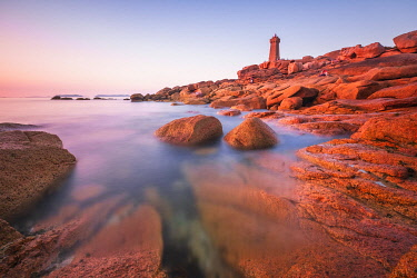 HMS3341956 France, Cotes d'Armor, Pink Granite Coast, Perros-Guirec, on the Customs footpath or GR 34 hiking trail, Ploumanac'h or Mean Ruz lighthouse at sunset