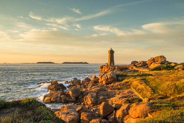 HMS3362038 France, Cotes d'Armor, Ploumanach, Perros-Guirec, Pink granite coast, the lighthouse of Ploumanac'h or lighthouse of Mean Ruz at sunset on the footpath of Customs or GR Grande 34 hiking trail