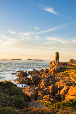 HMS3362039 France, Cotes d'Armor, Ploumanach, Perros-Guirec, Pink granite coast, the lighthouse of Ploumanac'h or lighthouse of Mean Ruz at sunset on the footpath of Customs or GR Grande 34 hiking trail