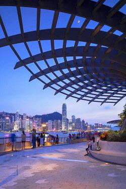 CH12049AW Skyline of Hong Kong Island and Tsim Sha Tsui promenade at sunset, Hong Kong