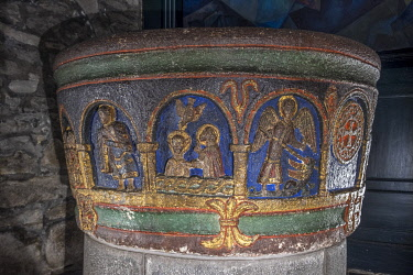 HMS3384665 France, Cantal, Mauriac, Notre Dame des Miracles church, polychrome Roman baptismal font carved in volcanic rock and decorated with 14 arches