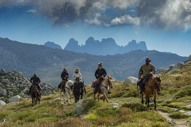HMS3408737 France, Corse du Sud, Alta Rocca, plateau of Cuscione, horse riding on the plateau around the Castellu d'Ornucciu with Justine Tauvel professor of the equestrian center, passage to the Canoso pass and...