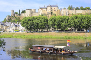 HMS3452440 France, Indre et Loire, Loire Valley listed as World Heritage by UNESCO, Chinon, traditional Ligerien boat trip (toue cabanee) on the Vienne river at the foot of the castle