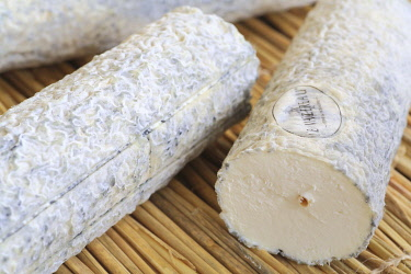 HMS3452456 France, Indre et Loire, Loire Valley listed as World Heritage by UNESCO, La Roche Clermault, cheese dairy Le Vazereau, Sainte Maure de Touraine (PDO) with raw goat milk with its famous straw power pla...