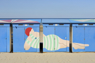 HMS3342411 France, Nord, Dunkerque, Malo-les-Bains, typical beach cabins with a woman lying painted on 3 cabins