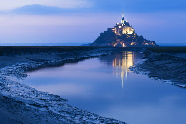 HMS3561155 France, Manche, Mont Saint Michel Bay listed as World Heritage by UNESCO, Abbey of Mont Saint Michel and River Couesnon, by night