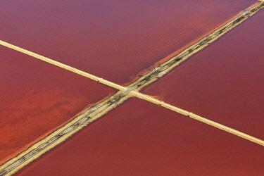 HMS3382734 France, Bouches du Rhone, Camargue Regional Nature Park, Arles, Salin de Giraud, salt marshes (aerial view)