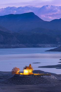 HMS3269947 France, Hautes-Alpes, the lake of Serre-Ponçon, at an abnormally low level, extremely rare phenomenon related to the weather of this winter 2018, Saint-Michel chapel on Saint-Michel islet