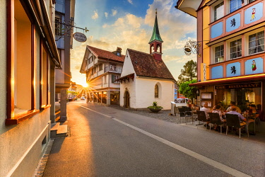 CLKFB114727 Sun rays filters between houses in the old town of Appenzell, Canton of Appenzell, Alpstein, Switzerland, Europe