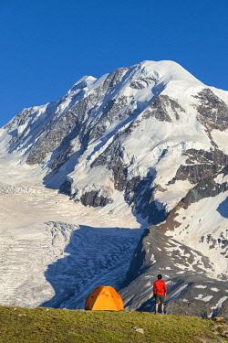 CLKGP115716 A trekker is looking the Lyskamm, one of the peaks of the Monte Rosa Massif close to Riffelsee Lake (Zermatt, Canton of Valais, Visp, Switzerlan, Europe) (MR)