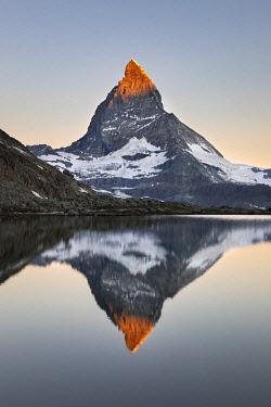 CLKGP115723 Matterhorn reflected in Riffelsee Lake at dawn (Zermatt, Canton of Valais, Visp, Switzerlan, Europe)