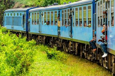 CLKMC113265 Ella, Uva District, Uva, Sri Lanka, Southern Asia. Moments of the scenic train ride between Kandy and Ella.