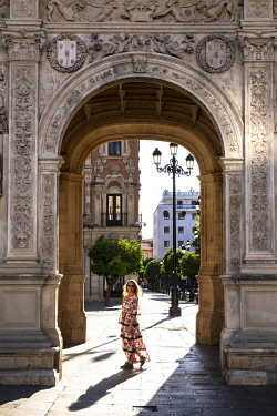 CLKST117332 A girl in a typical spanish dress walking in Seville, Andalucia, Spain  (MR)