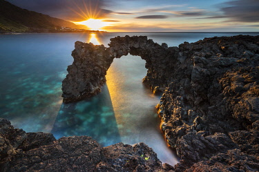CLKMB113622 Sunset at Faja da Ribeira da Areia and its arch, Sao Jorge, Azores, Portugal