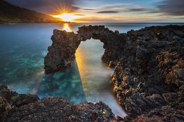 CLKMB113622 Sunset at Faja da Ribeira da Areia and its arch, Sao Jorge, Azores, Portugal