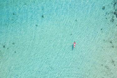 CLKCC118057 a vertical shot with beautiful girl enjoying the sea, Black River, Mauritius