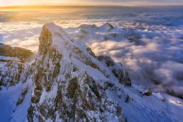 CLKMC114521 Aerial view of snowy peaks of Mont Blanc during sunrise, Courmayeur, Aosta Valley, Italy