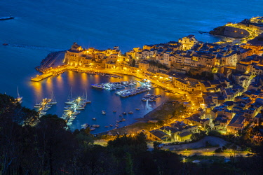 CLKGA115234 Elevated view of the fishing village Castellammare del Golfo at dusk, Trapani province, Sicily, Italy