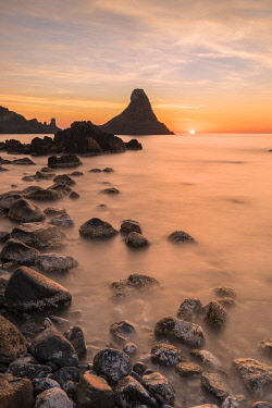 CLKGA115253 Cyclops stacks in Aci Trezza at sunrise, Catania Province, Sicily, Italy