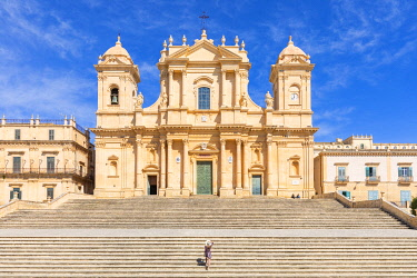 CLKGA115295 Tourist climbing the stairs of St nicholas church cathedral of Noto, Siracusa province, Sicily, Italy (MR)