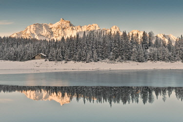 CLKMC98907 Sunrise on Lake Palù after an early snowfall Malenco Valley Valtellina Lombardy Italy Europe