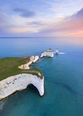 CLKMC113723 Aerial view at sunrise of the Old Harry Rocks, chalky formations near  Handfast Point, on the Isle of Purbeck in Dorset, Jurassic Coast, southern England.