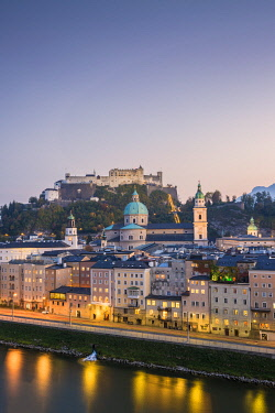 CLKGA114067 Historical old town of Salzburg reflected in Salzach river at dusk with Hohensalzburg Fortress in the background, Salzburg, Salzburger Land, Austria, Europe