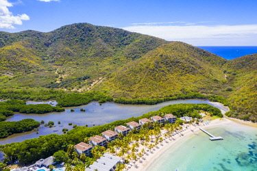CLKRM116306 Aerial view of luxury resort on palm-fringed beach from above, Carlisle Bay, Antigua, Antigua and Barbuda, Caribbean, West Indies