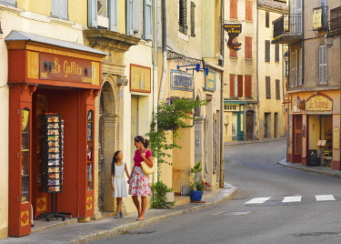 FRA11611AW France, Provence,  Alpes Cote d'Azur, Castellane, woman and girl shopping (MR)