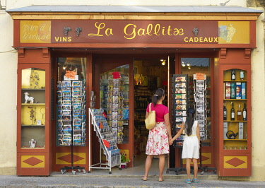 FRA11612AW France, Provence,  Alpes Cote d'Azur, Castellane, woman and girl shopping (MR)