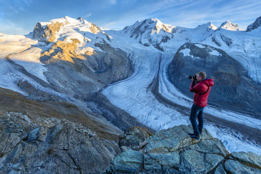 SWI8435AW Europe; Switzerland; Valais; Zermatt; Monte Rosa and Gorner glacier with photographer