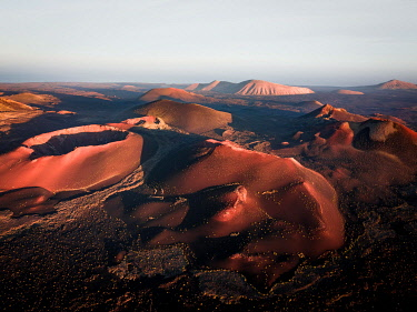 IBXLRE04927981 Sunrise volcanic crater, crater landscape, Timanfaya National Park, drone shot, Lanzarote, Spain, Europe