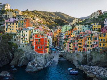IBXLRE04927998 Riomaggiore, aerial view, colorful houses, port, Cinque Terre, Liguria, Italy, Europe