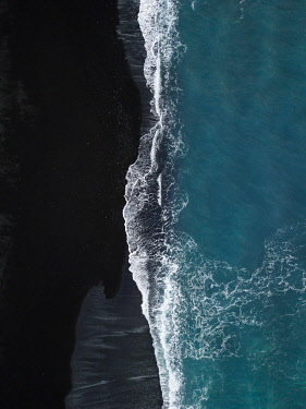IBXLRE04928044 Black volcanic beach with waves running out from above, black sand, drone shot, Lanzarote, Spain, Europe