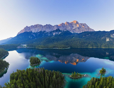 IBXMAN04970639 Eibsee lake with Wetterstein range and Zugspitze in the morning light, near Grainau, Werdenfelser Land, aerial view, Upper Bavaria, Bavaria, Germany, Europe