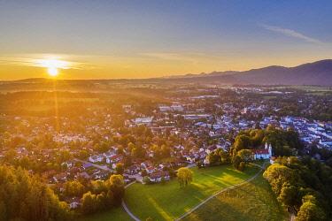 IBXMAN05027153 Bad Tolz with Calvary at sunrise, Isarwinkel, aerial view, Upper Bavaria, Bavaria, Germany, Europe