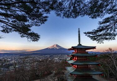 IBXMMW04971181 Five-story pagoda, Chureito Pagoda, with views over Fujiyoshida City and Mount Fuji volcano at sunset, Yamanashi Prefecture, Japan, Asia