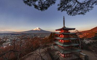 IBXMMW04971185 Five-story pagoda, Chureito Pagoda, with views over Fujiyoshida City and Mount Fuji volcano at sunset, Yamanashi Prefecture, Japan, Asia