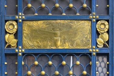 IBXMZC04959897 Gold-coloured relief of a bee at a wrought-iron gate around 1900, Art Nouveau, Czernowitz, Ukraine, Europe