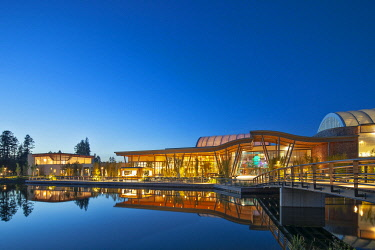 The main leisure services / pool building in the Forest setting of the Center Parcs leisure facility at twilight in Hinznang, Leutkirch im Allgäu, Baden Württemberg, Germany.